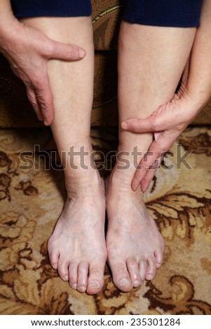 Legs of senior woman. Feet care and massage