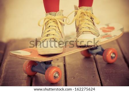 Legs of skateboarder. Closeup view - stock photo