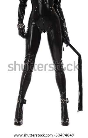Legs of slim sexy woman in black latex catsuit with cuffs and whip on white background - stock photo