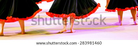 legs of the dancers during the performance of flamenco dancing in Spain - stock photo