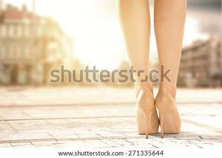 legs of woman and street of city  - stock photo