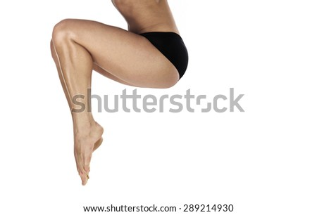 Legs of woman jumping on a white background. Horizontal photo - stock photo