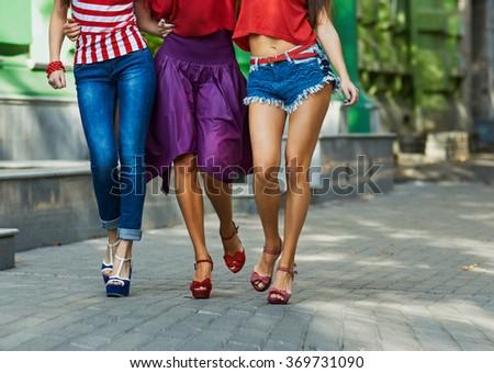 legs Of Women On City Street - stock photo