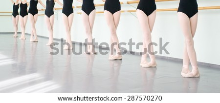 legs of young dancers ballerinas in class classical dance, ballet - stock photo