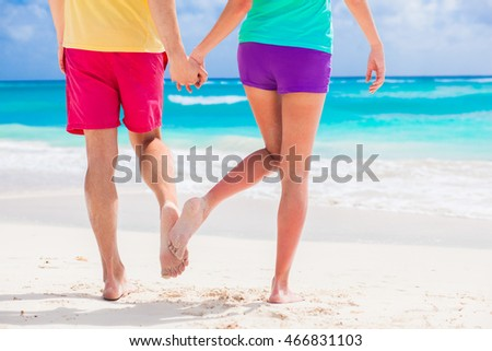 legs of young lovely couple on tropical turquoise barbados beach