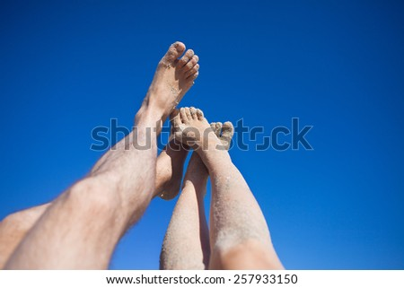 legs on the beach - stock photo