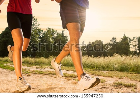 Legs View Of A Couple Jogging Outdoor in the Park  - stock photo