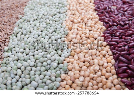 legumes background, with kidney beans, chick peas, green peas, lentils - stock photo