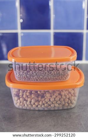 Legumes kept in tupperware - stock photo