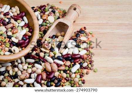 legumes on wood, closeup, background - stock photo