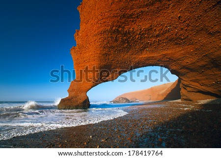 Legzira dramatic natural stone arches reaching over the sea, Atlantic Ocean, Morocco, Africa - stock photo