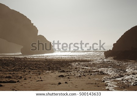 Legzira dramatic natural stone arches reaching over the sea, Atlantic Ocean, Morocco, Africa,  Legzira stone arches sunset lights
