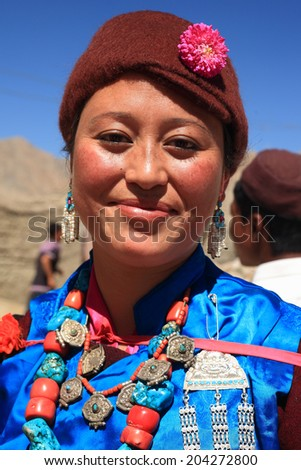 LEH, INDIA - SEPT 01 : An unidentified Ladakhi tribal woman in her  traditional wear poses as she participates in the cultural procession during Ladakh Festival on September 01, 2012 in Leh, India. - stock photo