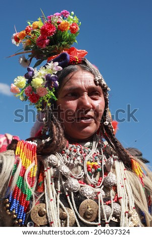 LEH, INDIA - SEPT 01 : An unidentified Ladakhi tribal woman wearing traditional costumes participates in the cultural procession during Ladakh Festival on September 01, 2012 in Leh, India. - stock photo