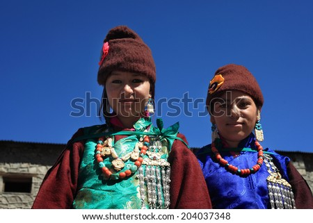 LEH, INDIA - SEPT 01 : Two unidentified Ladakhi tribal women wearing traditional dress pose as they participate in the cultural procession during Ladakh Festival on September 01, 2012 in Leh, India. - stock photo
