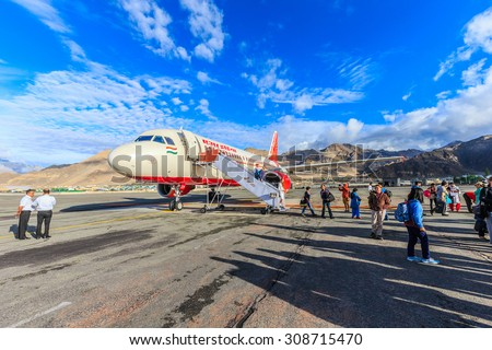 LEH, LADAKH, INDIA - AUG 5: Air India at Kushok Bakula Rimpochhe Airport on Aug 5, 2015 in Ladakh. It' the flag carrier airline of India owned by Air India Limited, a Government of India enterprise. - stock photo