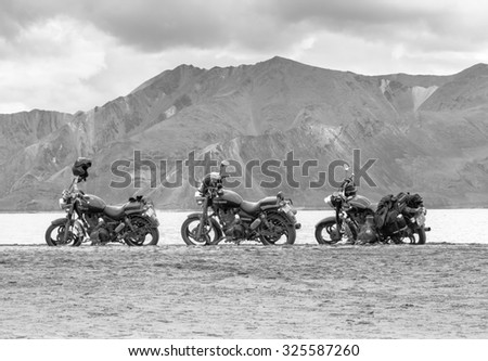 LEH LADAKH , INDIA - AUGUST 11 : The black and white photo of motorcycles are parking beside Pangong lake in summer in Leh Ladakh,India on August 11, 2015.