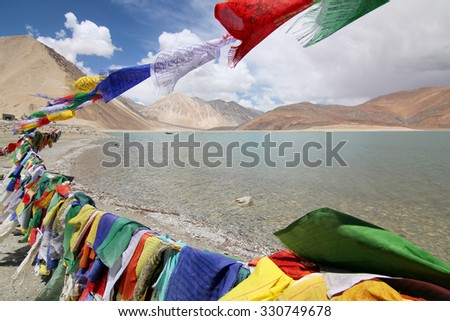 LEH LADAKH, INDIA - JULY 24, 2015: Pangong Lake (Pangong Tso) with prayer flags, Ladakh , Jammu and Kashmir, India.