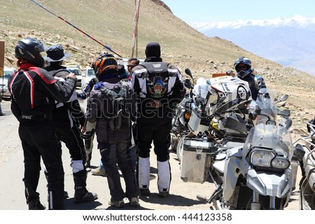 Leh (Ladakh), India - June 23, 2014 : Bikers group near a police check post on the way to Khardungla Pass world highest motorable Road.