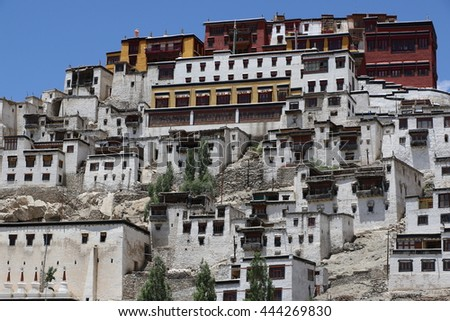 Leh (Ladakh), India - June 24, 2016 : Thiksay Tibetan Buddhist monastery is located on top of a hill in Thiksey village, near Leh in Ladakh, India. Visitors reguraly come to pray here. - stock photo