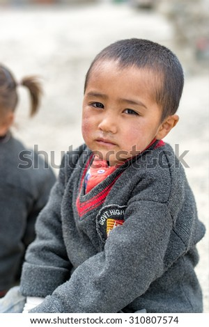 LEH LADAKH,INDIA-20 MAY 2014:  Boy  preparing to school in the morning is looking camera in Ladakh, India.