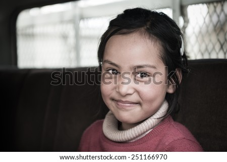 LEH,LADAKH, INDIA - MAY 7:Young unidentified Tibetan girl, poses for a photo on May 6, 2014 in Leh Ladakh, Northern India. There are many Tibetan refugees living in Ladakh. - stock photo