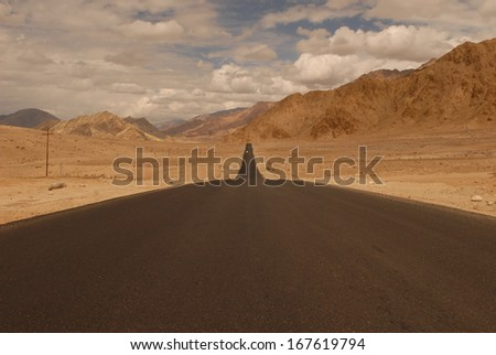 Leh-Manali Highway stretching into the distance - stock photo