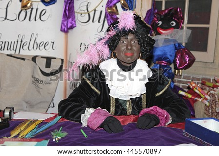 Leiden, The Netherlands - November 2011: Black Pete, a dutch character, in the house of Sinterklaas