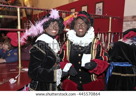 Leiden, The Netherlands - November 2011: Two black pete's, dutch characters, in the house of Sinterklaas - stock photo