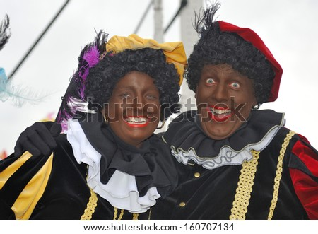 LEIDSCHENDAM, THE NETHERLANDS - NOVEMBER 13, 2010: Two Black Petes laughing in the camera during the arrival of Sinterklaas in Holland. November 13, 2010 Leidschendam, Holland - stock photo