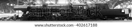 LEIPZIG, 5 APRIL: A steam locomotive in the central train station in Leipzig on 5 April 2016. Panoramic view, black and white photography.