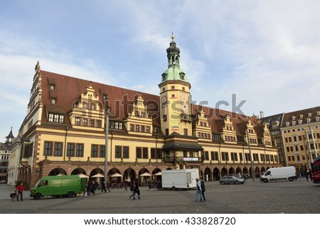 LEIPZIG, GERMANY - APRIL 8, 2016. View of Altes Rathaus on Markt square in Leipzig, with surrounding buildings, people and cars, at dusk.