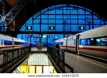 Leipzig train station at night with two speed trains about to leave - stock photo