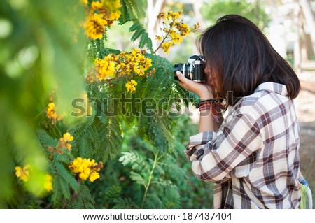 Leisure activities of girl photographer in fine weather - stock photo