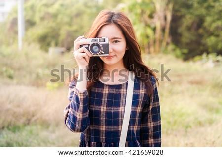 Leisure activities of girl photographer in fine weather - stock photo