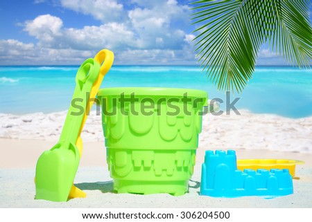 Leisure activities with colorful toys on the sunny beach