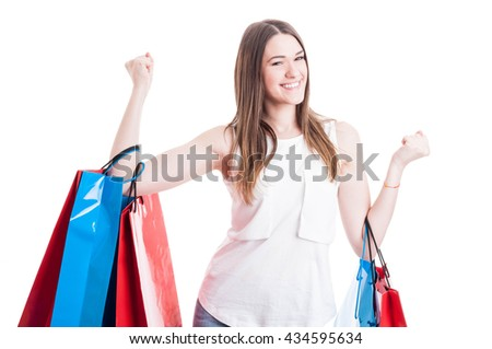 Leisure activity concept with happy female enjoying shopping and holding colored gift bags isolated on white - stock photo