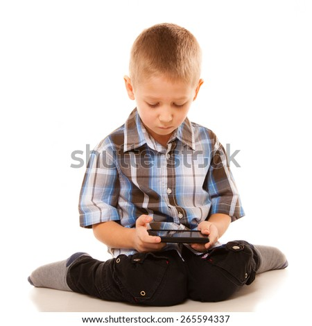 Leisure, technology and internet concept - little boy with smartphone playing games or reading text message