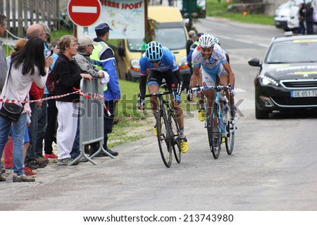 LELEX, FRANCE - AUG 15: Dan Martin and Remi Di Gregorio riding Le Tour de l'Ain UCI Europe Tour Pro Race on August 15, 2014 in Lelex, Monts du Jura, France. Bert-Jan Lindeman won the race. - stock photo