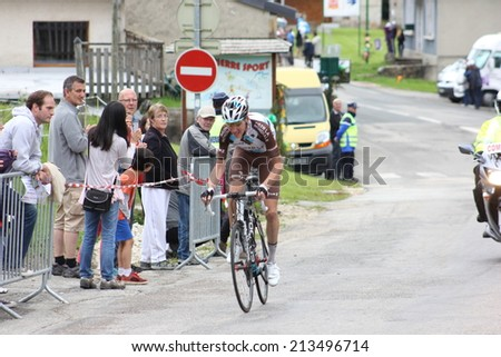 LELEX, FRANCE - AUG 15: Romain Bardet riding Le Tour de l'Ain UCI Europe Tour Pro Race on August 15, 2014 in Lelex, Monts du Jura, Ain, France. Bert-Jan Lindeman won the race. - stock photo