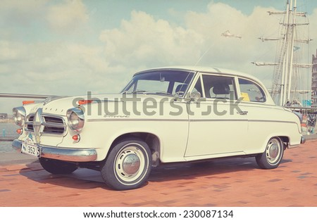 LELYSTAD, THE NETHERLANDS - JUNE 16, 2013: 1958 Borgward Sedan Isabella TS is on display at the annual National Oldtimer day. Textured filtered image in a retro nostalgic look. - stock photo