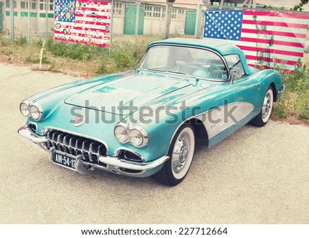 LELYSTAD, THE NETHERLANDS - JUNE 16, 2013: 1958 Chevrolet Corvette Convertible is on display at the annual National Oldtimer day. Textured filtered photograph in a nostalgic retro style. - stock photo