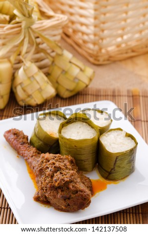 Lemak Lemang, traditional Malaysian food made of glutinous rice, coconut milk and salt. Cooked in a hollowed bamboo stick lined with banana leaves. Served during ramadan festival or hari raya. - stock photo