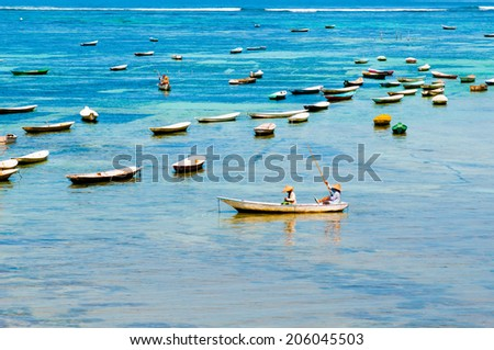 LEMBONGAN, INDONESIA, MAY 12: People in a boat in Lembongan island on May 12, 2014 in Lembongan, Indonesia. This is traditional boats in a village near beach in Lembongan island