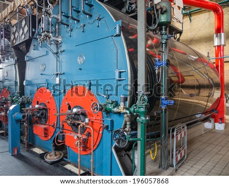 LEMMER, NETHERLANDS - 2 MARCH 2014: Inside the boiler house of historic Wouda steam pumping station from 1920, the the largest of its kind and still in operation.  - stock photo