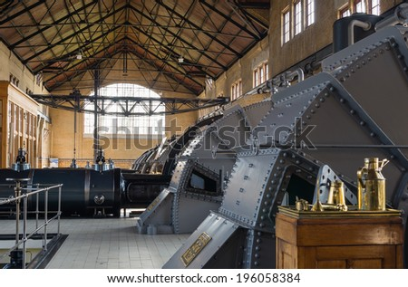 LEMMER, NETHERLANDS - 2 MARCH 2014: Inside the machine room of historic Wouda steam pumping station from 1920, the largest ever built still in operation. It pumps away excess water in Friesland. - stock photo
