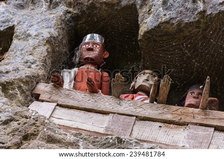 Lemo, South Sulawesi, Indonesia - circa september 2014: balconies of statues, effiges of the dead persons (tau tau in local language) in the burial site of Lemo, Tana Toraja, South Sulawesi, Indonesia - stock photo