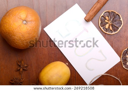 lemon and cinnamon, old fruits and anise on wooden plate - stock photo