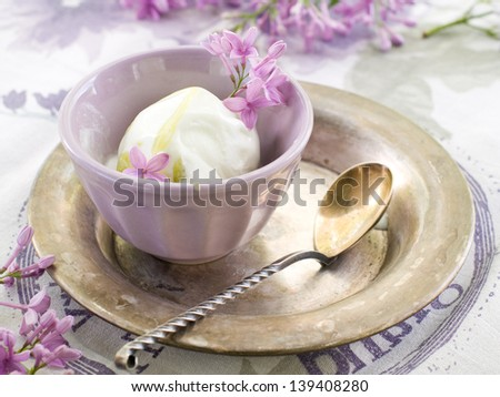 Lemon and lavender  ice cream in vintage bowl, selective focus - stock photo