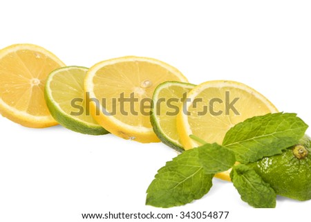 Lemon and lime mixed slices isolated on white